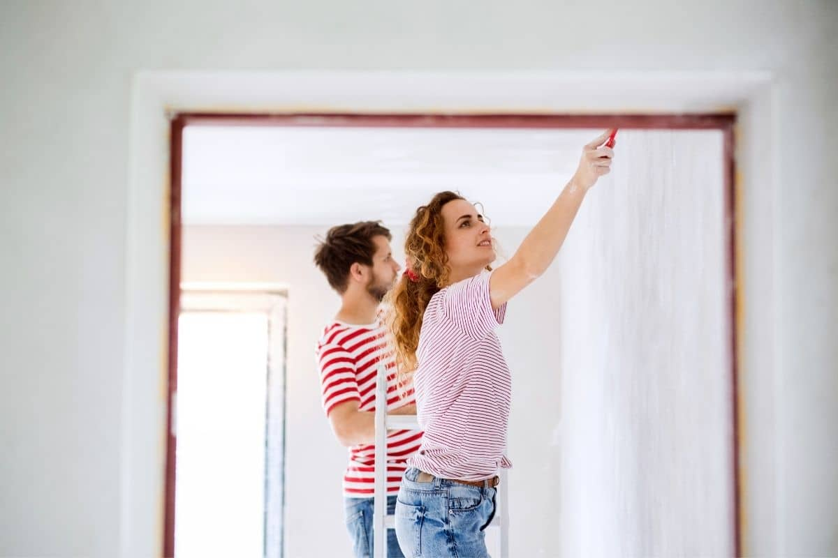 couple paints interior room together