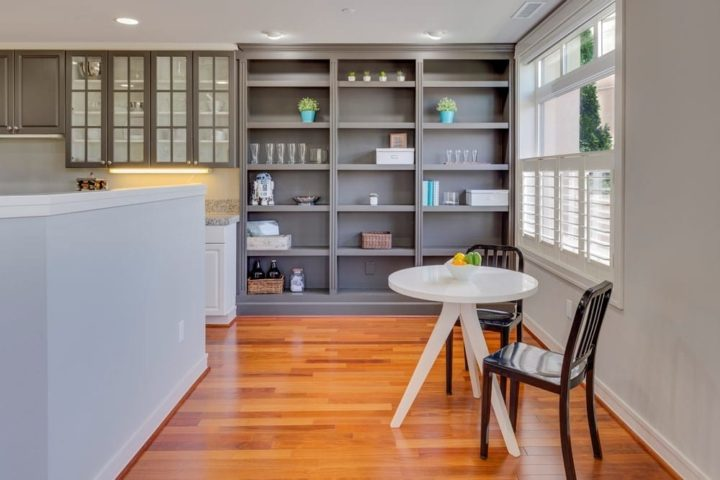 Greay painted walls with timber floorboards