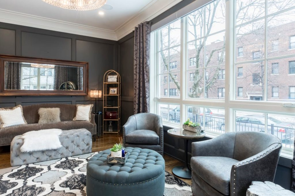 Using a dark grey panelling to match a living room with big windows