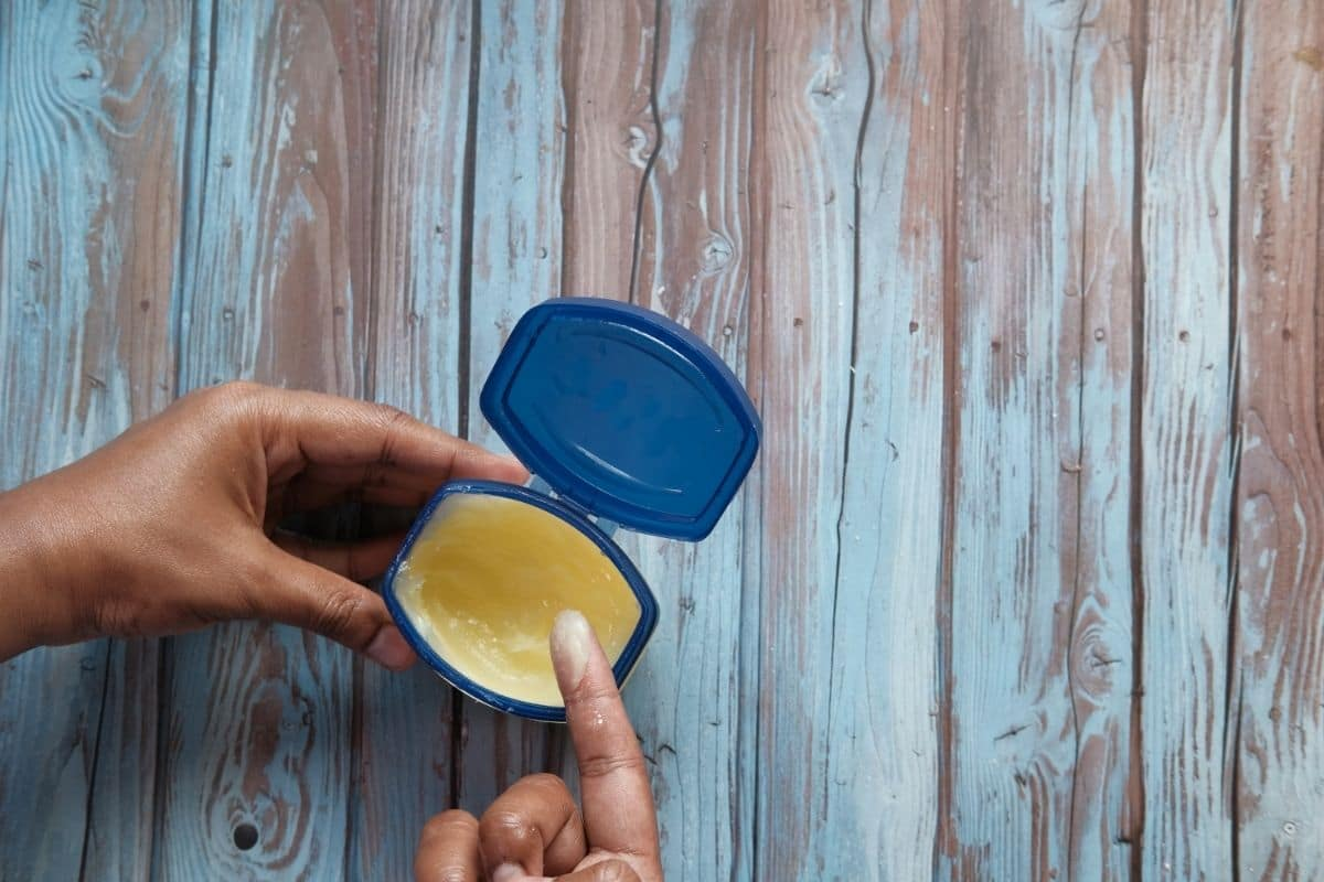 hand using petroleum jelly
